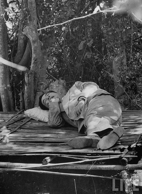 May-1956 South Vietnam's President Ngo Dinh Diem sleeping under the trees during his trip to visitrefugee settlements