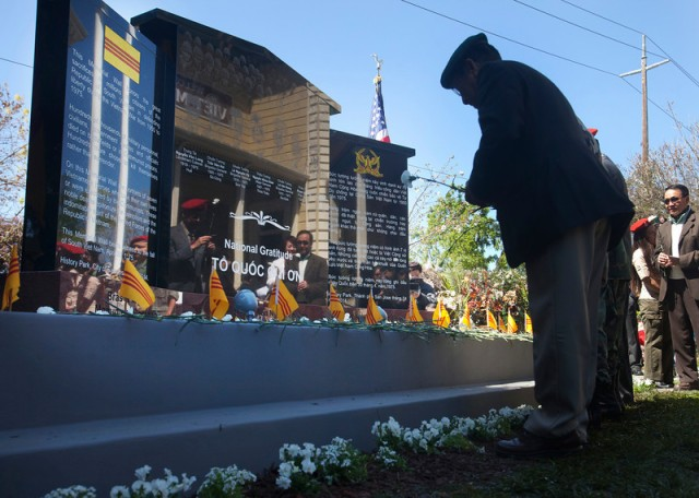 Attendees place flowers on a memorial wall on Saturday, April 5, 2014, outside the Viet Museum at History Park in San Jose, as a memorial wall was unveiled to the thousands who fought and died in defense of South Vietnam. Seven ÒheroesÓ were singled out for special honors, and while they are meant to represent all the soldiers under their command, these seven are notable because six took their own lives rather than allow themselves to be captured, and the seventh--who was captured--was executed in front of the people he protected.  (Patrick Tehan/Bay Area News Group)