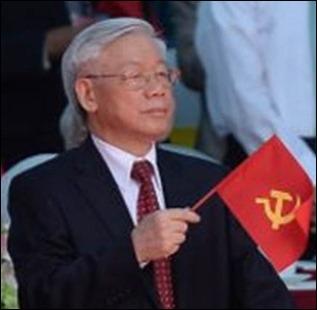 Tổng Bí Thư Nguyễn Phú Trọng đang cầm cờ Đảng Cộng Sản VN